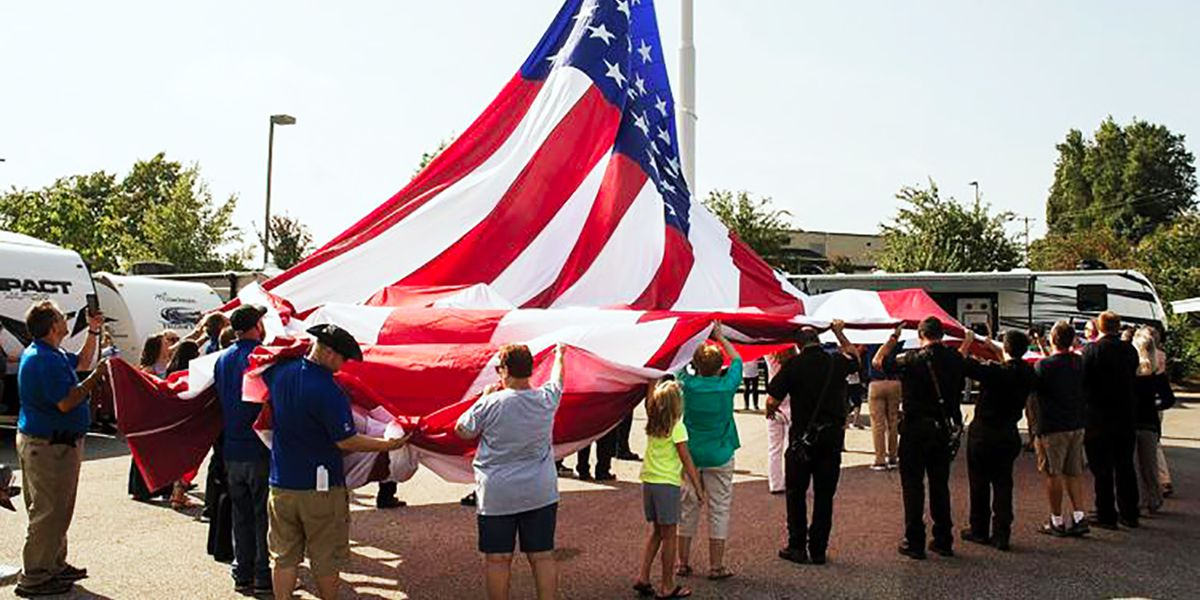 Camping World CEO blasts Statesville council, vows flag 'isn't coming down'