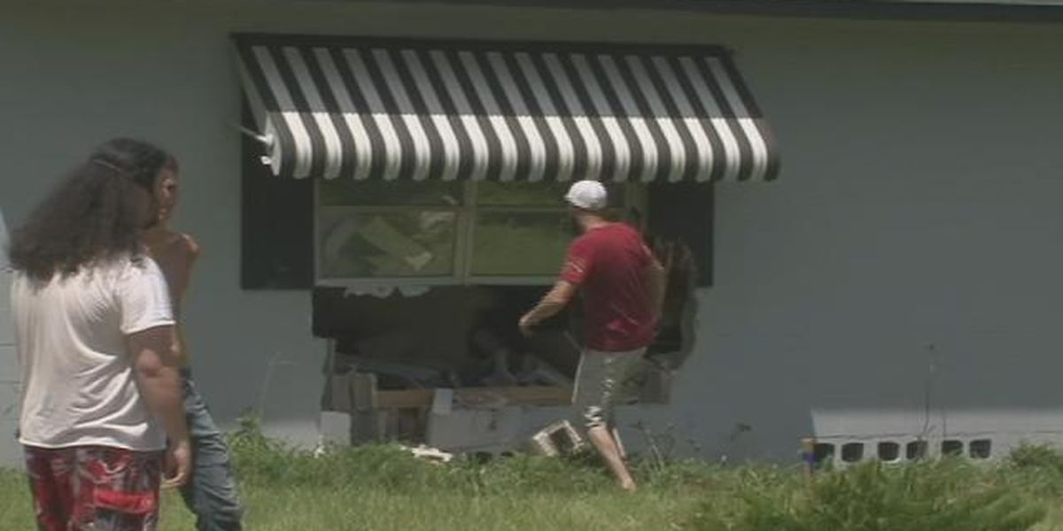 Man goes flying on couch after car crashes into Florida home