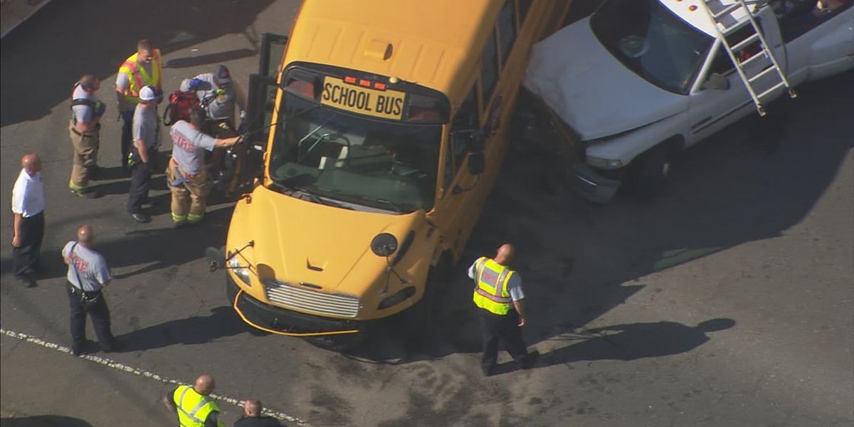 Two drivers hurt after pickup truck crashes into school bus in Huntersville, police say
