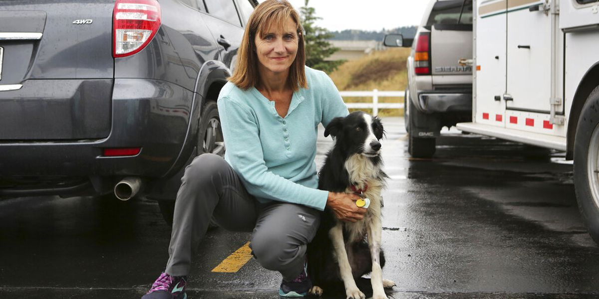 Washington woman finds lost dog after quitting job to search for 57 days
