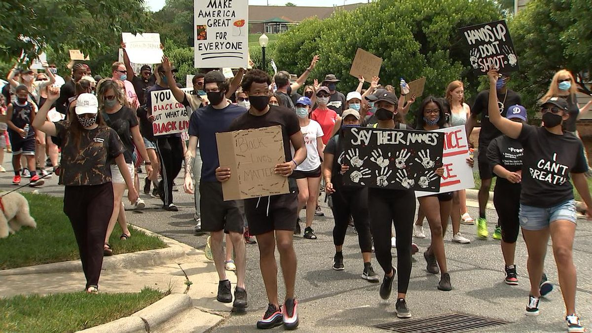 'Bring our community together': Dozens march through Concord neighborhood