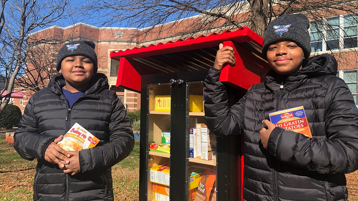 Brothers build mini food pantry to help neighboring tent city