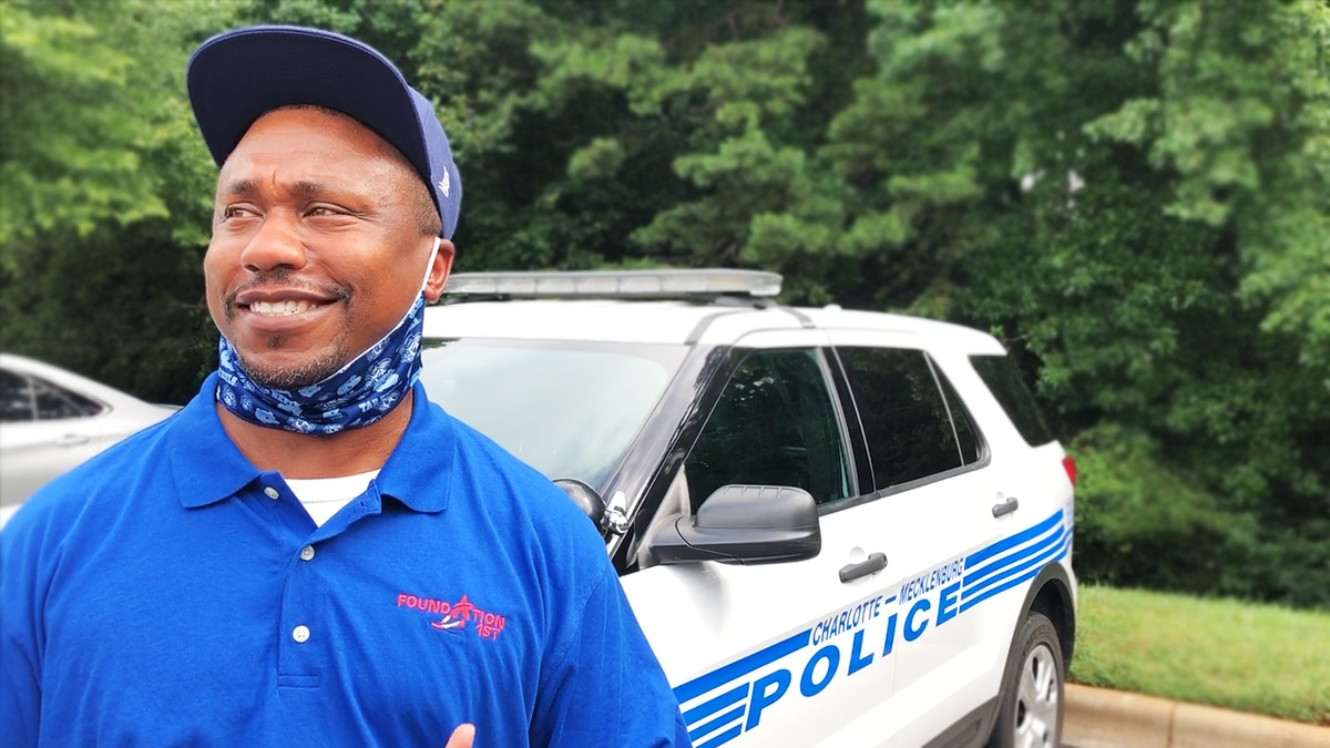Dad gives back to CMPD program that helped transform his son