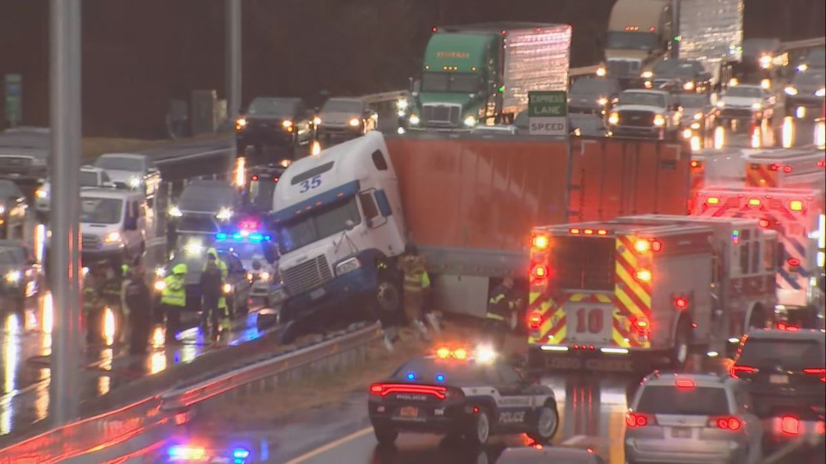 Tractor-trailer stuck on top of median shuts down I-77 in Huntersville for hours