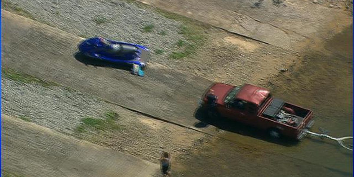 Officials: Woman injured when personal watercraft flies over truck